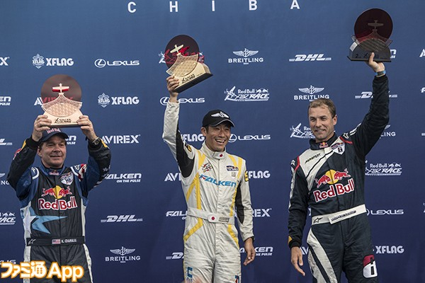 Yoshihide Muroya of Japan (C) celebrates with Martin Sonka of the Czech Republic (R) and Kirby Chambliss of the United States (L) during the Award Ceremony of the third stage of the Red Bull Air Race World Championship in Chiba, Japan on June 5, 2016.